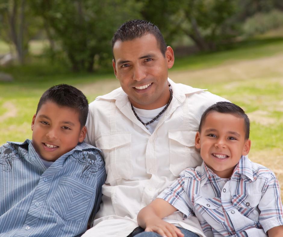 happy hispanic father and kids family